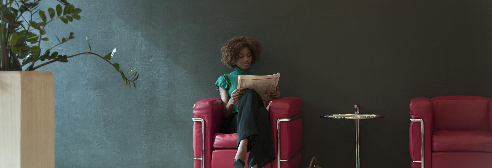 Image of woman reading a paper