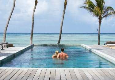 Couple Relaxing On Vacation At Luxury Resort In The Caribbean